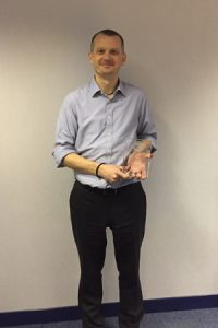 Mark Budgen holding SystemActive's International HP Winners Award