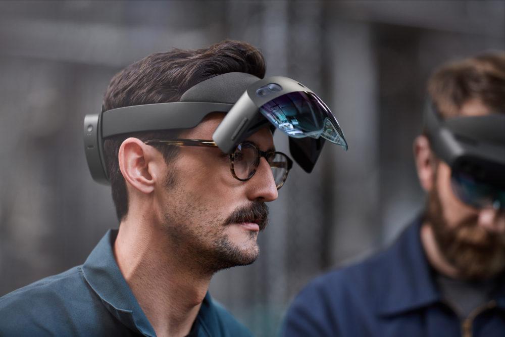 Man wearing HoloLens 2 man with visor flipped